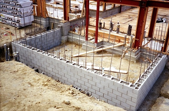 Dry stacked interlocking masonry system mortarless for Concrete block house