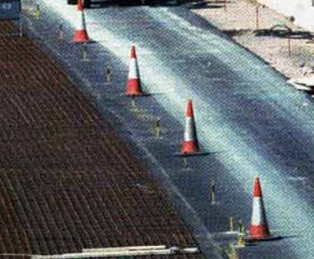 Continuous Reinforced Concrete Pavement with Successive Whisper Concrete Resurfacing
