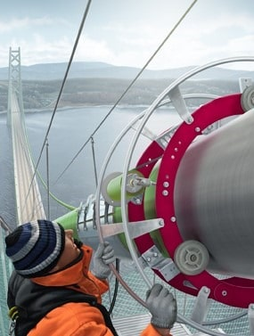Elastomeric Wrapping of Suspension Bridge Main Cable
