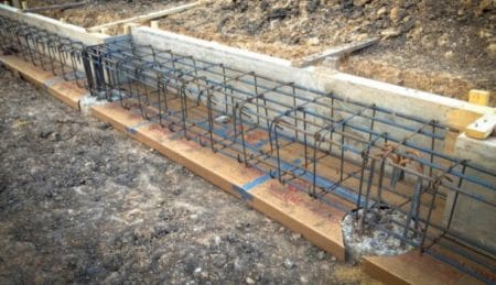 Shuttering bottom and one side of grade beam and placed reinforcement