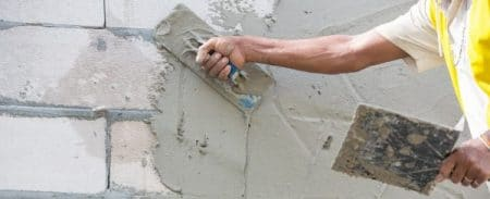 Applying of base coat of plastering for brick masonry
