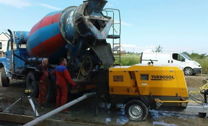 Concrete Mixer Feeding Concrete Pump