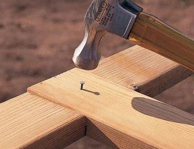 Driving Nail into Timber