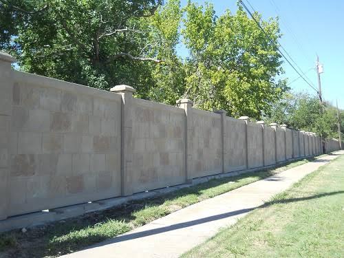 Precast concrete fence.