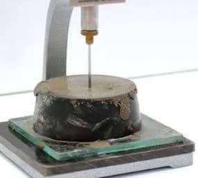Penetration the Needle into Concrete Mixture