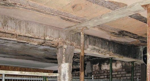 Spalling of Reinforced Concrete Beam Due to Exposure to Fire