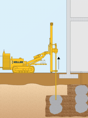 Compaction grouting below the foundation of existing structure.
