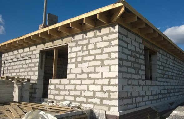 Construction of house using Concrete Block Masonry.